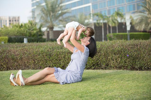 Wie kann ich schnell abnehmen - Mutter mit Kind