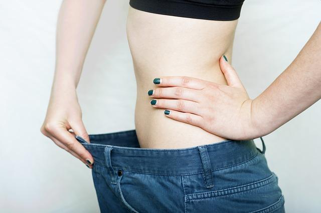 Fettweg-Pillen - Abnehmende Frau